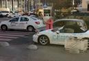 В центре Киева блондинка с топором изуродовала Porsche (ВИДЕО)